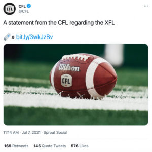 A closeup of a football resting on a field with the text: A statement from the CFL regarding the XFL